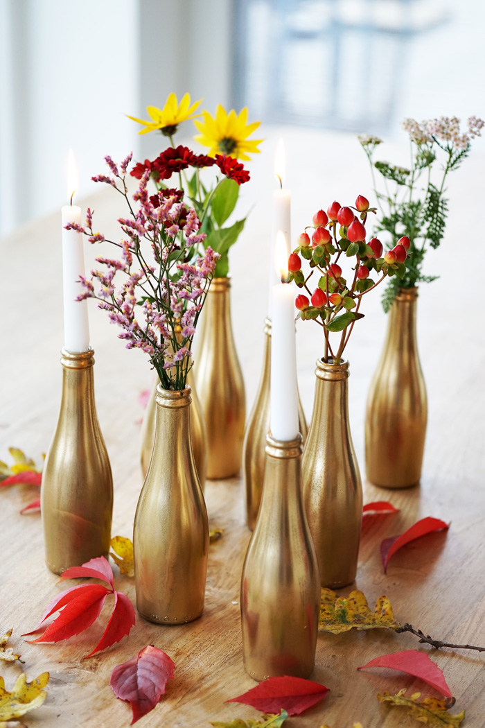 autumn flowers in small bottles vases