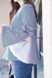 Chicwish Bluse mit Glockelärmeln zur Ripped Jeans
